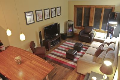 Open living area with gas fireplace in the corner