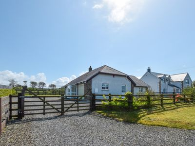 Photo for Sitting just above the charming seaside village of New Quay, Awelon is a light and spacious cottage,