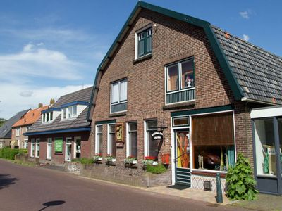 Photo for Cosy holiday home in the pleasant village centre of Egmond-Binnen