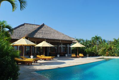 Villa Cerah, Bali. The terrace with sunbeds at the pool