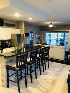Open kitchen floor plan with new appliances breakfast bar and dining area