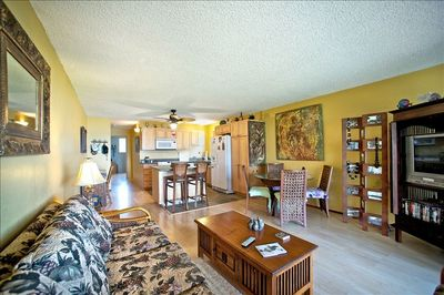 Large, comfortable living space with dining table, tv, and separate desk too!