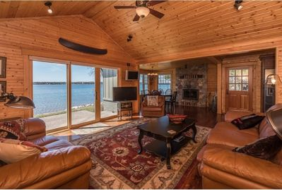 Relax in the main room of the cabin with beautiful views of the lake.