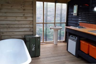 Kitchenette and bathroom open to Bush