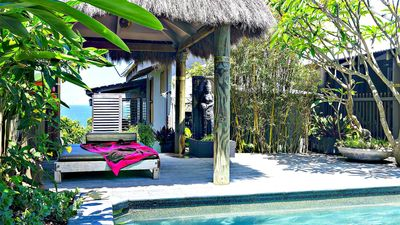 Balinese gazebo with private pool in tropical gardens
