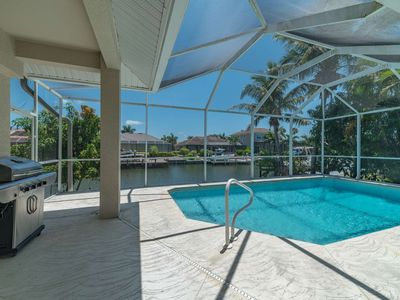 Photo for New Listing! Waterleaf Court - Spacious and Elegant Waterfront Home with Heated Pool and WiFi