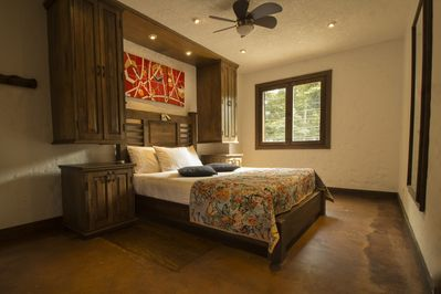 Master Suite/Bedroom #1 with attached private bathroom. Oversized, custom bed.