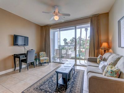 Photo for Open, airy condo, Beach service included, convenient to entertainment