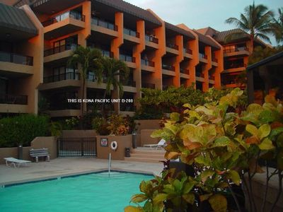 This is our condo at sunset. Corner, wrap-a-round lanai over looking the pool.