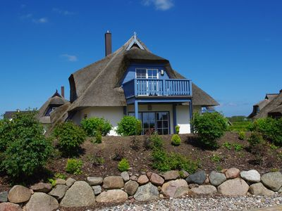 Photo for Family-friendly house under thatch, sauna, fireplace, bicycles, pets welcome