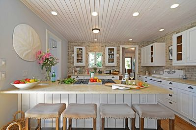 Chef's kitchen with island seating