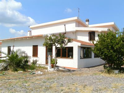Photo for Turquoise house 20 meters from the sea with private descent