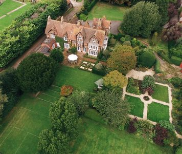 Aerial shot of The Grange and its gardens in the summer