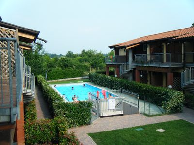 Photo for Apartment, the lake, amusement parks, two bedrooms, swimming pool, air conditioning