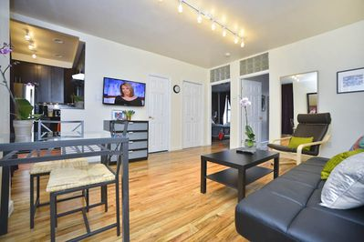 Overall view of the living and dining area of this spacious apartment.