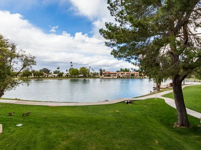 Photo for Lake Front Balcony! Quiet community! Walking path! Restaurants! Heated Pool