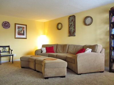 Our large couch easily fits four and is a great place to cuddle.