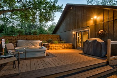Relaxing deck with hot tub, grill and lots of seating