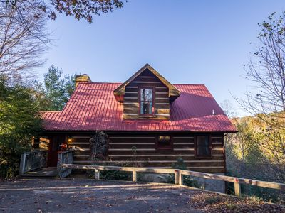 Photo for River Ridge - 3 story log cabin with Hot Tub - Pet Friendly - Walk to the New River