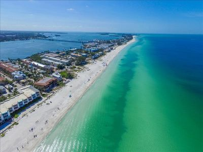 Photo for **MAY SPECIAL  $800/WEEK **    SUMMER IS RIGHT AROUND THE CORNER.  THIS 2 BR 2 BA  IS STEPS FROM THE BEACH   #209 RUNAWAY BAY.  OPEN FLOOR PLAN   SLEEPS 4.