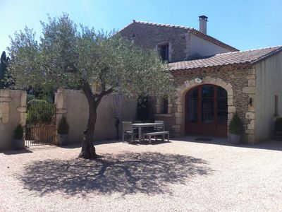 Photo for At the gates of Uzès, renovated character cottage in large property with swimming pool