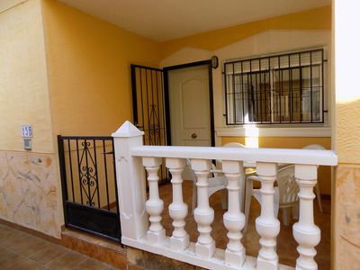 Photo for 2 bed apartment in gated community with communal pool, tennis, aircon .