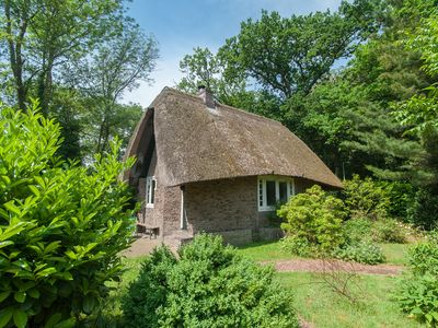 Photo for Romantic, monumental thatched holiday home in the park of Meerwijk