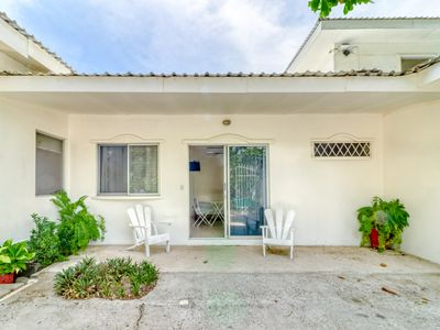 Photo for Cozy, waterfront villa w/ beach access, gardens, & a lovely, shared pool