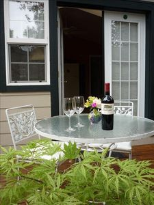 Charming outdoor attached private deck for morning coffee or evening dining.