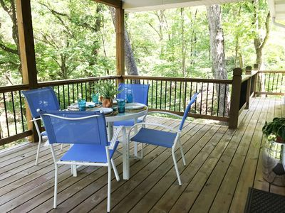Private patio amongst the trees.  Tables and chairs for dining and entertaining