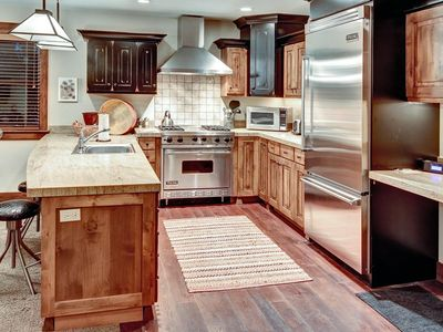 Photo for Single-level condo steps from chairlift -- on-site concierge, winter shuttle service, heated pool