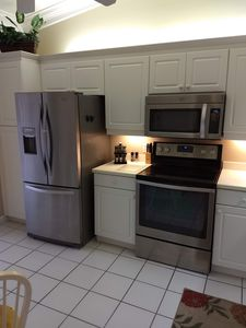 Kitchen with all stainless steel appliances.