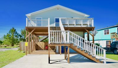 Photo for PET FRIENDLY, PRIVATE COTTAGE, POOL, COVERED RELAXING AREAS, PEDESTRIAN CROSSWALK TO BEACH