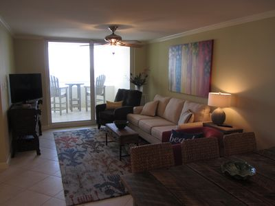 Living Room opens to balcony with beautiful view of the Gulf!