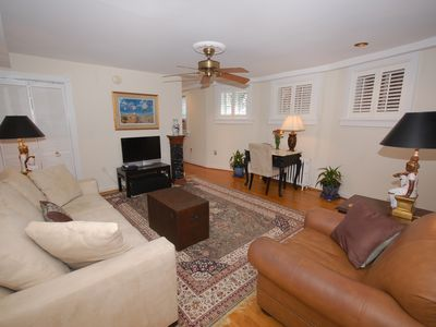 Large open living room. Sofa opens to a queen bed. Satellite TV here & bedroom