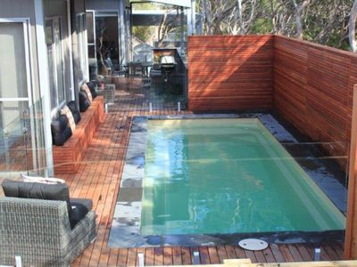Photo for With sparkling lap pool and brilliant covered entertaining deck to enjoy