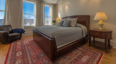 Master Bedroom. King sized bed. Spacious. Cable TV/Roku. Leather Chairs.