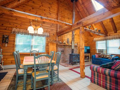 Photo for Winnipecabin - Lovely log cabin w/ water access & hot tub - close to everything!
