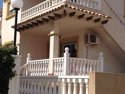Photo for Spanish style apt close to 3 beaches & 3 golf courses. Wi Fi & Sat TV, Air con