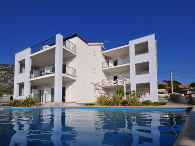 Photo for Apartment Roberto with pool DIRECTLY on the beach with stunning sea views