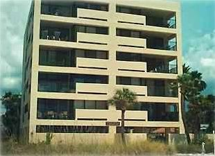 This wonderful beach front condo, on bottom right, has easy access to the beach.