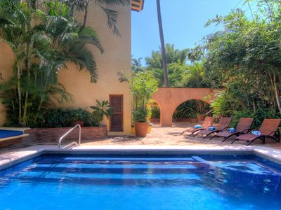 Photo for Gorgeous Beach front Villa, Jacuzzi ,heated pool , full staff two meals service