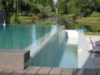 Photo for Contemporary villa 190 m2 with infinity pool and golf views