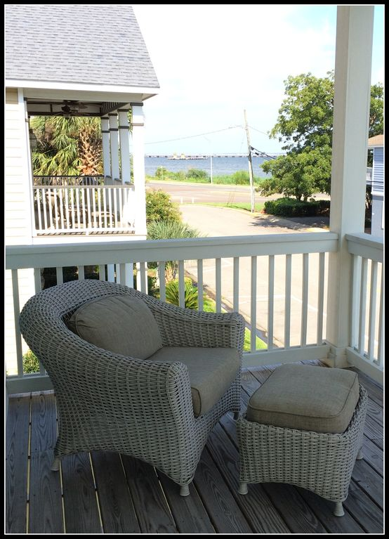 Outdoor Seating On Second Story Balcony Overlooking Pensacola Bay.