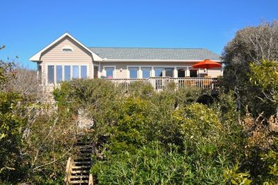 View of house from end of private boardwalk to beach.