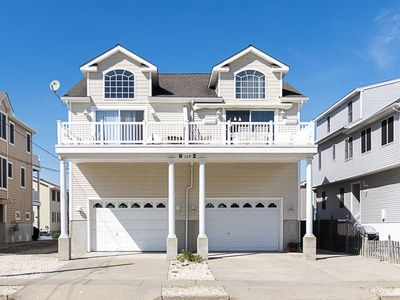 Photo for Beautiful bay views from all three decks with breathtaking sunsets. Ocean and sunrise views off front deck.