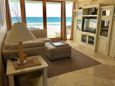 Living room with oceanfront balcony.  Smart LED TV, DVD player