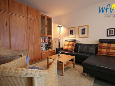 Photo for Modern apartment with balcony - right on the Wangerooger beach promenade!