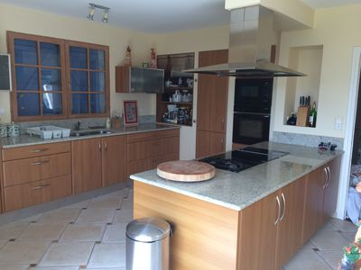 Granite countertop, 2 gas cooker, 4 induction cooker and an electric grill.