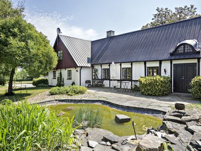Photo for Pleasant apartment in genuine four-winged old farm near the sandy beaches of Österlen